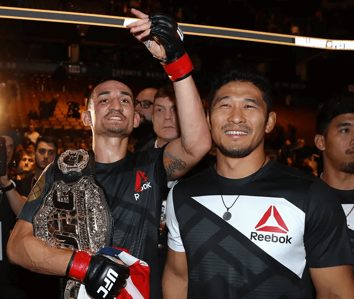 max holloway with unified featherweight belt
